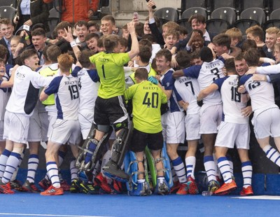 The boys celebrate with their fellow pupils from Reed