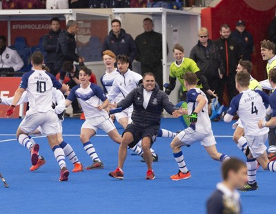 The team rush to celebrate with Head of Hockey at Reed