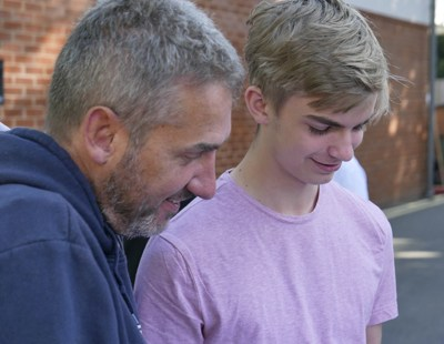 Student Joe Sheridan shows teacher Tim Rushbrooke his amazing GCSE results at Reed